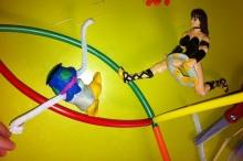 Xena battles Sculpey monster.